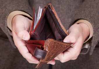 Businessman showing empty wallet. Finance and economy.