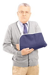 Senior man with broken arm posing