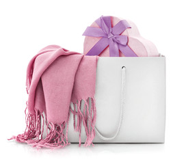 Pink scarf in shopping bag with gift box