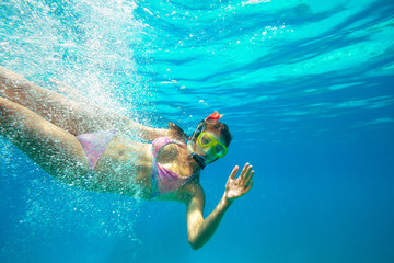 Underwater shoot of a young lady snorkeling