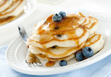 stack of blueberry pancakes with syrup.