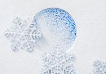 Snowflake on the snow.