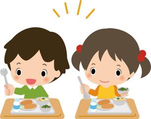 学校給食を食べる男の子と女の子