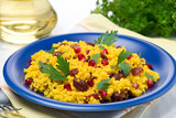 couscous with curry, dried cranberries and herbs
