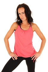 confident attractive female fitness model standing