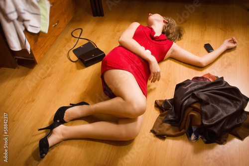 Victim of an armed robbery lying on the floor
