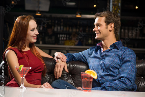 Young couple talking in a nightclub