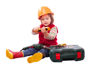 Child in builder hardhat with tools