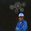 Black man worker with chalk gears blackboard
