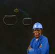 Black man worker with chalk jumping fish bowls background