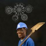 Black man worker with chalk gears blackboard
