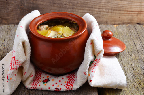 Potatoes with meat in a ceramic pot