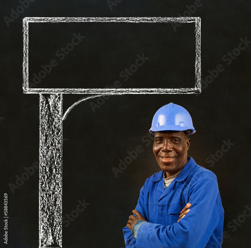 Black man worker with a chalk road advertising sign