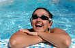 Woman smile at the side of a swimming pool