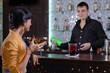 Barman chatting with a female customer