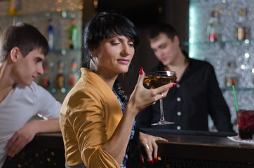 Women drinking at a pub counter