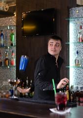 Barman serving a customer