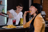 Young woman enjoying a snack at the bar