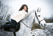 Girl on a horse.winter landscape