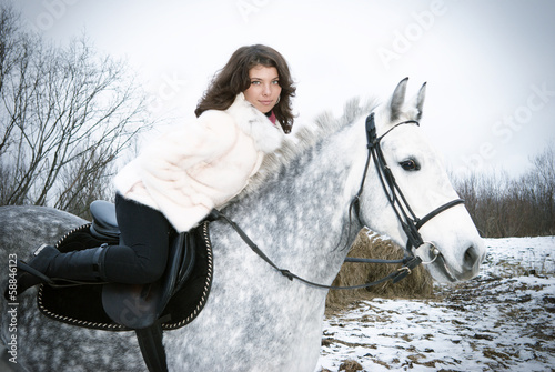 Girl on a horse.winter landscape