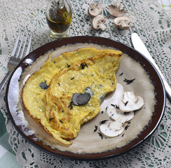 scrambled eggs with mushrooms and truffle