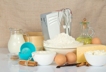 Mixer, sieve and products for dough