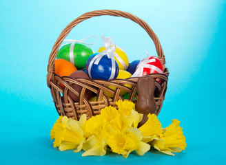 Easter eggs in basket decorated with ribbons