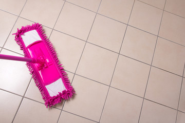 cleaning the floor with purple mop