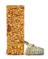 Muesli Bar with measuring tape  isolated on white background