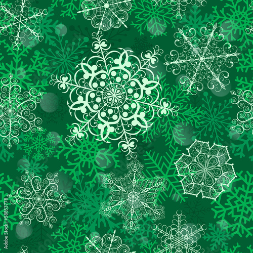 Christmas seamless pattern with big snowflakes on green