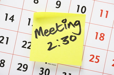 Meeting Reminder Sticker on a Wall Calender