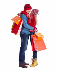 Happy couple with christmas shopping bags.