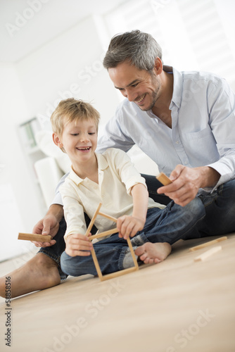 father and son building a small house