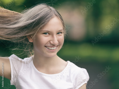 young girl holding her hair in hand