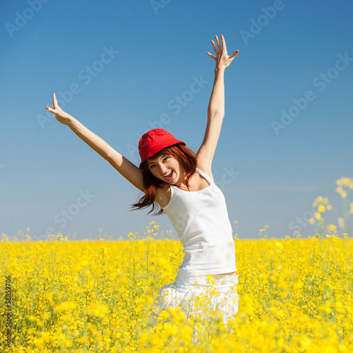 Happy woman in the field with flowers