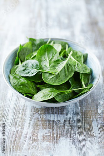 Fresh baby spinach leaves in a bowl