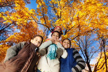 Group of kids in autumn park