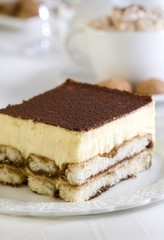 Piece of delicious tiramisu in a cafe.