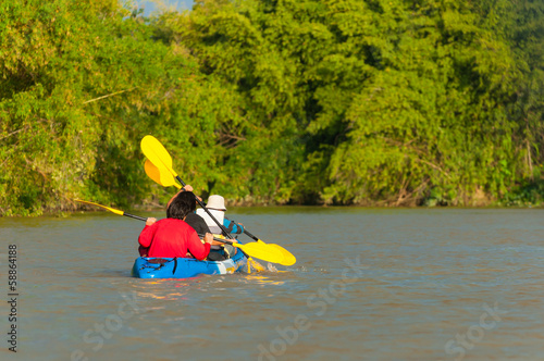 people kayaking in the river