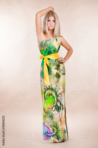 Fashion vogue woman in colorful summer dress in studio