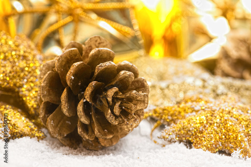 golden pinecone against christmas background