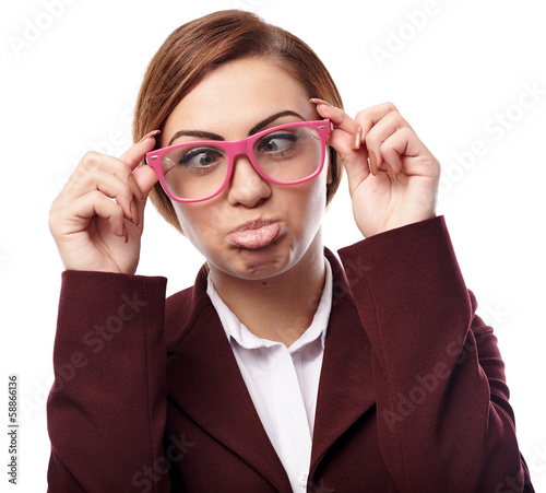 Woman wearing nerg glasses and making funny faces
