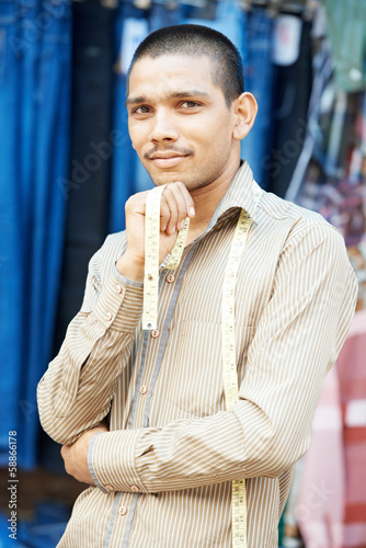 Young indian tailor man