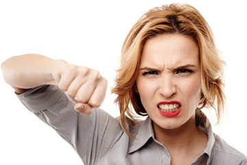 Angry businesswoman punching