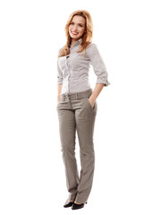 Cheerful businesswoman with hand on hip