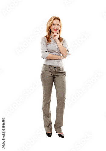 Cheerful businesswoman with hand on chin