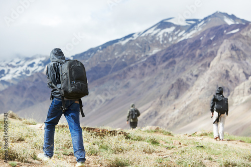 three tourist hiking in india mountains