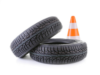 Car tires and road cone