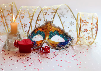 Christmas composition with a mask, gifts and candles