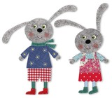 pair of bunnies cut out of felt and wool